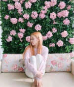 Rosé in front of some roses