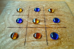 File:Roman-board-game-tic-tac-toe-ancient-its-blue-amber-colored-playing-stones-table-display-museum-61095299.jpg