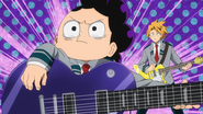 Mineta trying to play the guitar