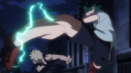 Izuku Midoriya kicks Katsuki Bakugo in the face