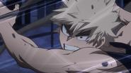 Katsuki Bakugo continuing to attack Izuku