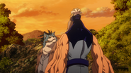 Chimera grabs Mezo by the head