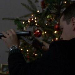 Bourne loads the shotgun