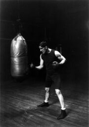 James J. Corbett with punching bag cph.19131