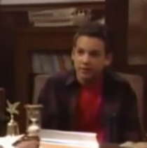 Cory sitting on a chair