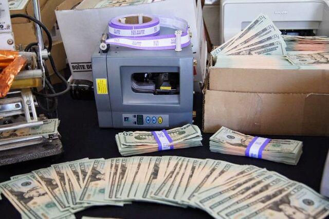 File:20140131counterfeit-american-bills-1.jpg