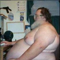 Naked-fat-man-at-computer