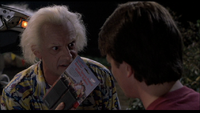Doc giving Marty the walkie talkie