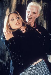 Spike about to take a bite out of Buffy