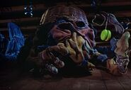 Closet monster playing with a lime green yo yo