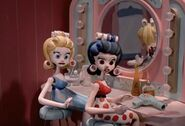 Cute dolls with curlers in their hair