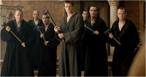game of thrones the sparrows wearing robes and wielding weapons