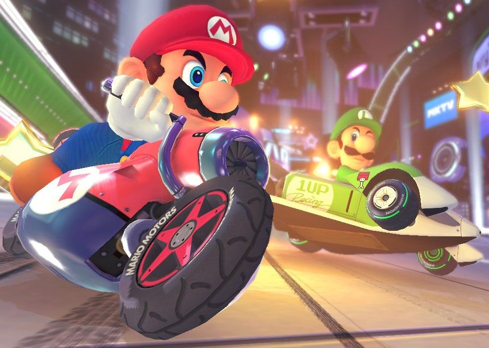 Mario rides a motorcycle in Mario Kart while Luigi and Yoshi trail him in the background