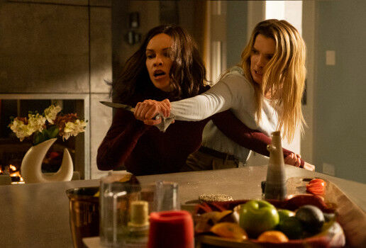 Betty Gilpin's Crystal tackles Hilary Swank's Athena in The Hunt.
