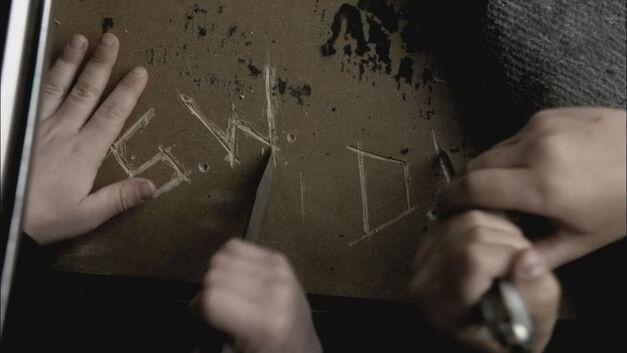 supernatural swan song episode kids carve initials in car door