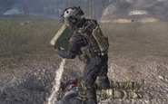Shadow Company member pouring gas on Roach and Ghost