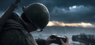 Stiles using his camera on D-Day WWII