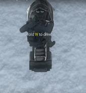 Metal 0-4 riding a snowmobile