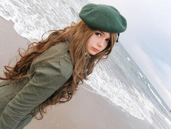 Beach-coast-coat-curly-hair-girl-Favim.com-345108