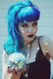 Aquamarine holding a small disco ball