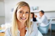 Happy-woman-in-loft-office