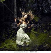 Stock-photo-portrait-of-romantic-woman-at-fairy-forest-59926690