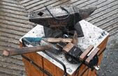 10984574-forge-tools-on-an-anvil