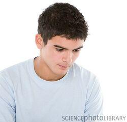 F0028472-Sad teenage boy-SPL