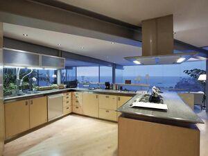 Retro-pretty-kitchen-pretty-beach-house-large-glass-wall
