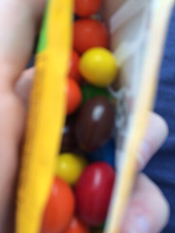 File:Peanut m and m in wrapper.jpeg