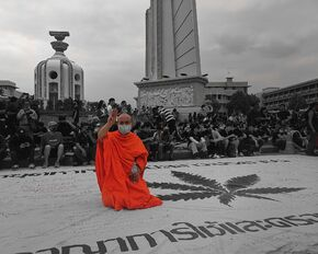 Thailand. Buddhist monk flashing the 3-finger Hunger Games salute
