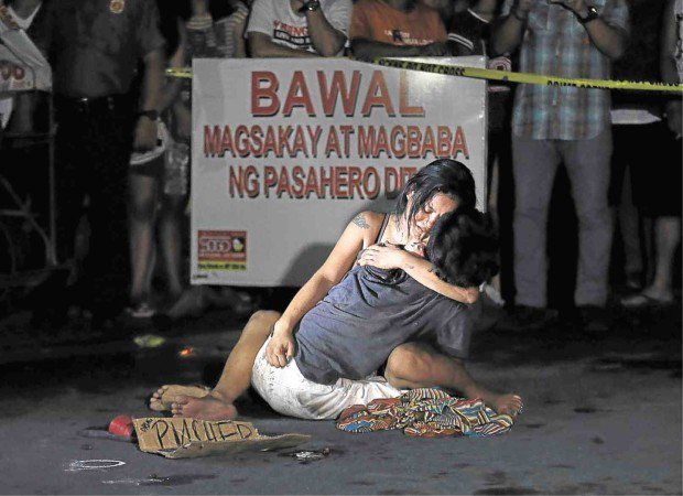 File:Jennelyn Olaires hugs murdered partner Michael Siaron, 30, killed by presidential Philippines death squad in July 2016.jpg