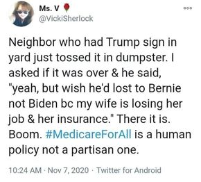 Trump sign in the dumpster