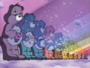 The Care Bear Stare in the colors of the rainbow