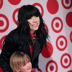 Carly poses for a picture with a young fan.
