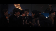 Freddy talking to Vic at the prom