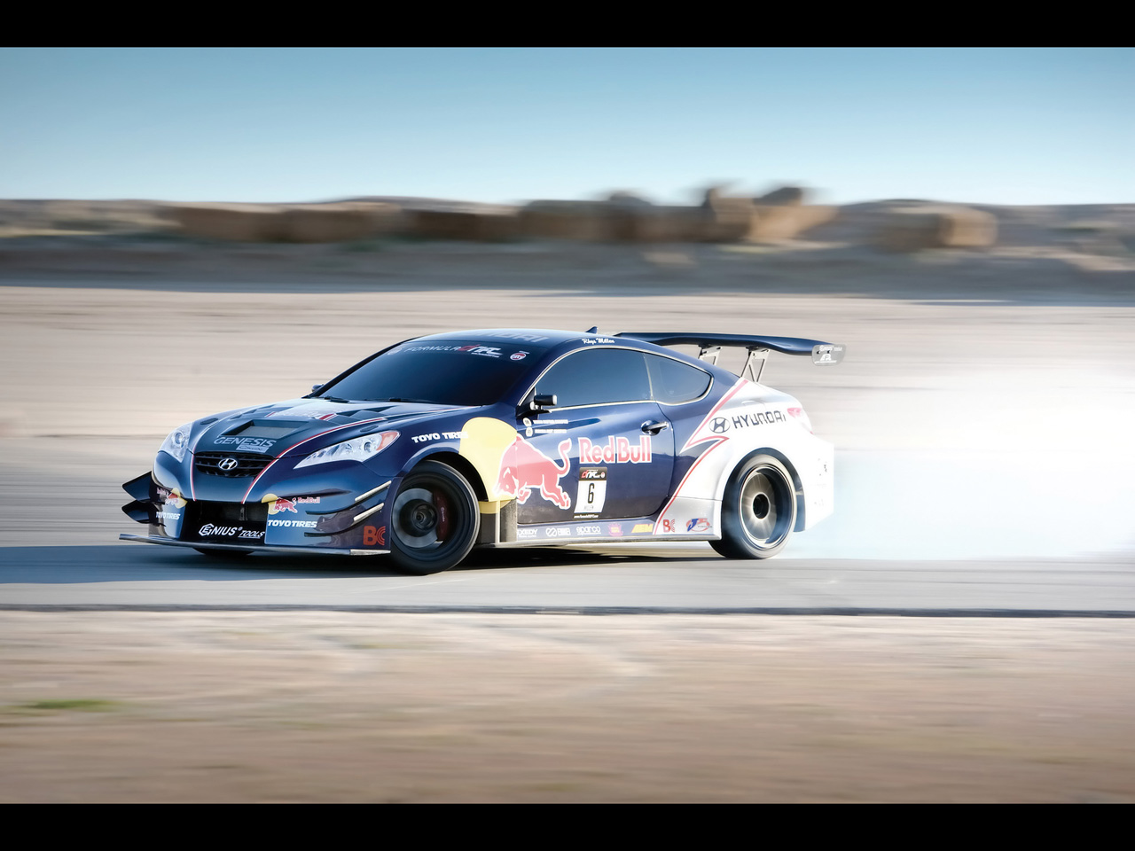 2009-RMR-Red-Bull-Hyundai-Genesis-Coupe-Front-And-Side-Speed-1280x960