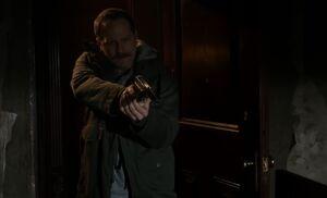 S01E23-Proctor gun at Holmes