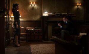 S04E22-Watson Holmes ring