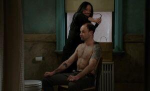 S05E13-Watson shaving Holmes