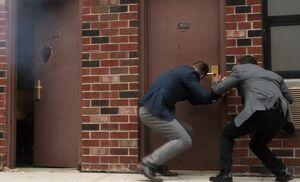 S03E03-Holmes Bell shutgunned door