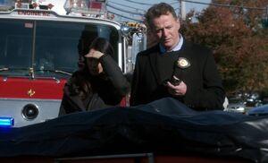 S03E11-Watson Gregson body bag
