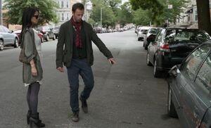 S01E03-Watson Holmes point at car