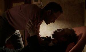 S01E15-Holmes grabs Rhys