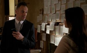 S03E13-Holmes Watson debt wall
