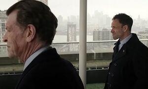 S04E23-Morland Sherlock balcony