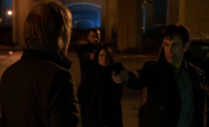 S02E22-Marchef gun at Mycroft