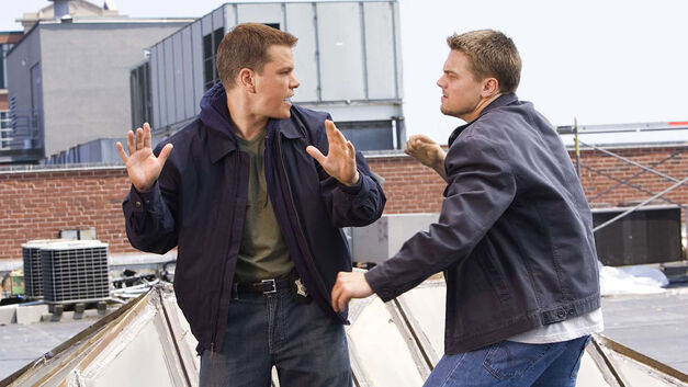 the departed matt damon with hands up and leonardo dicaprio ready to punch