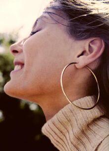 Woman wearing hoop earrings