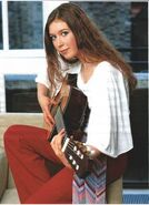 Hayley Westenra playing her guitar